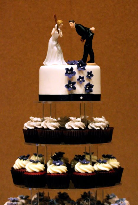the cake topper was adorable the favors were customized cracker jack boxes to go with the baseball theme